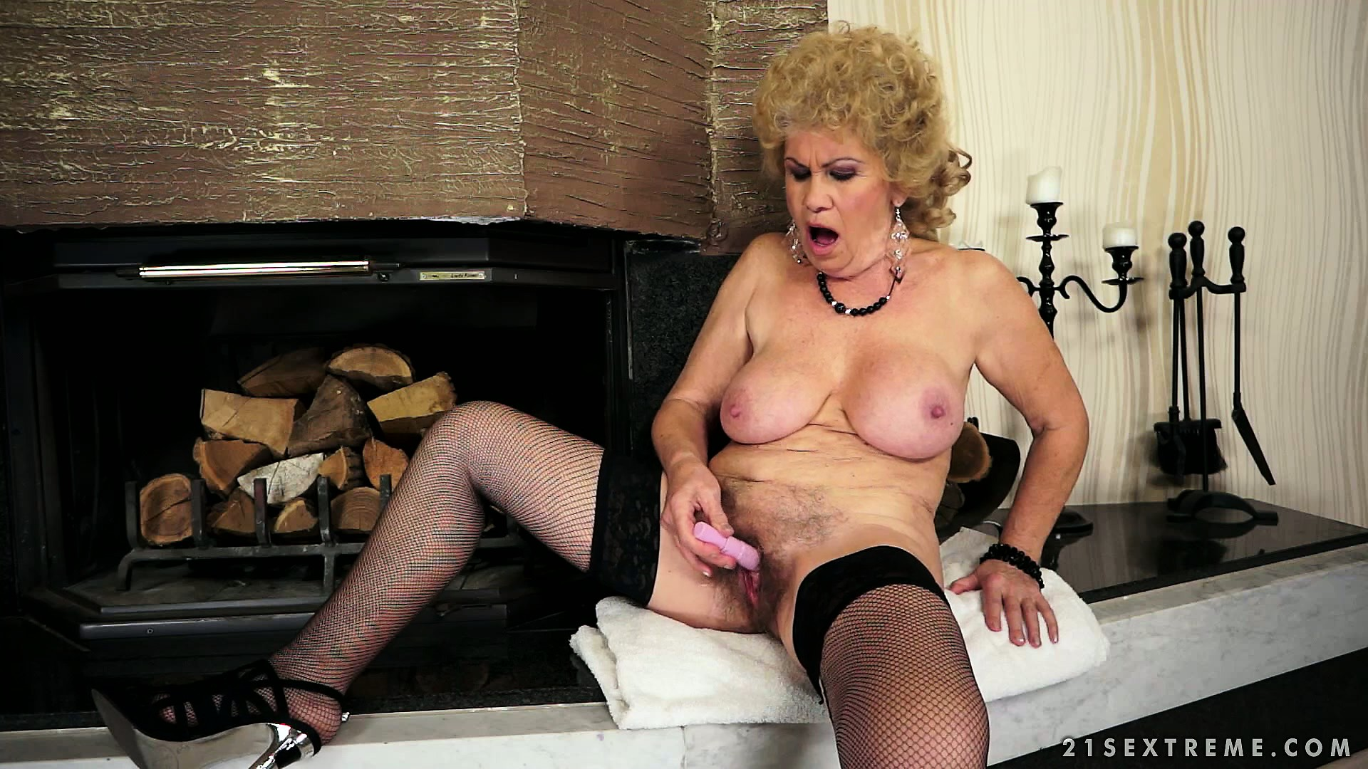 Porn Tube of Busty Mature Lady Has A Dildo Drilling Her Cunt And A Vibrator Pleasing Her Clit