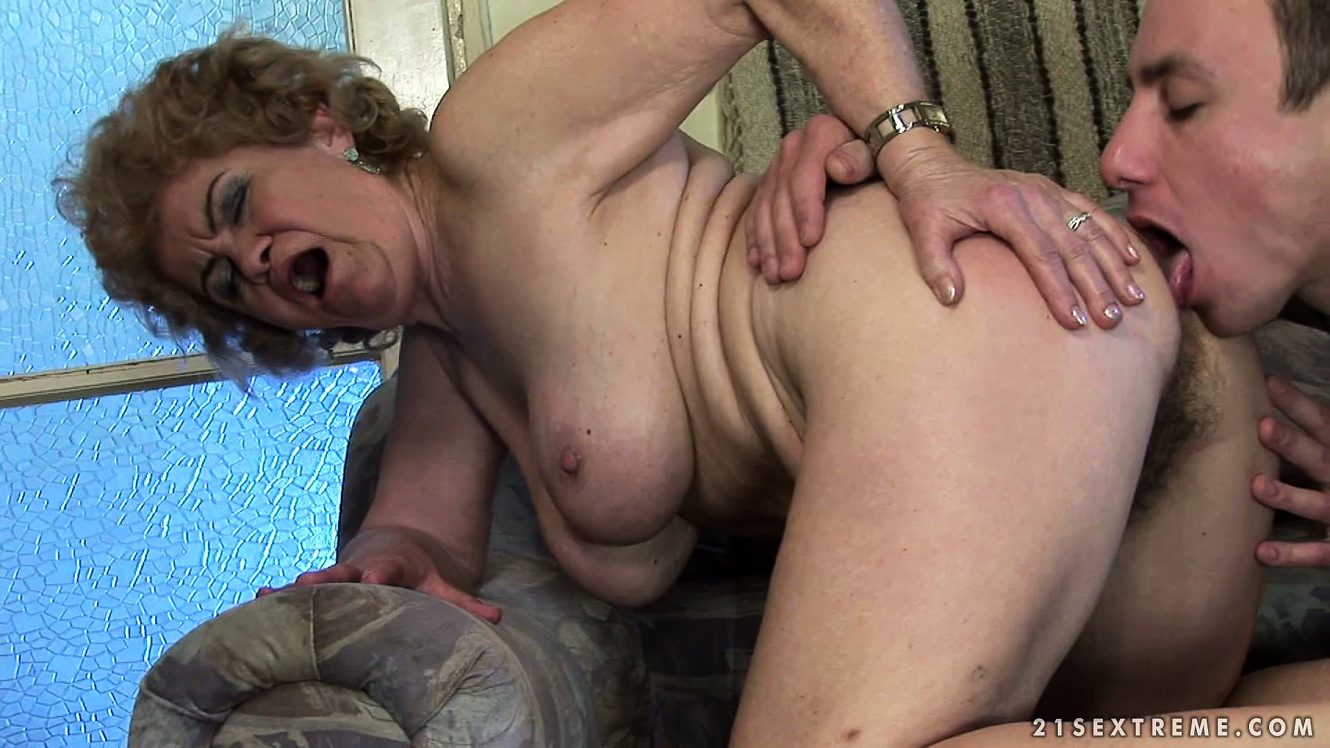 Porno Video of Granny Gets Her Feet And Her Hairy Pussy Worshiped By Young Guy