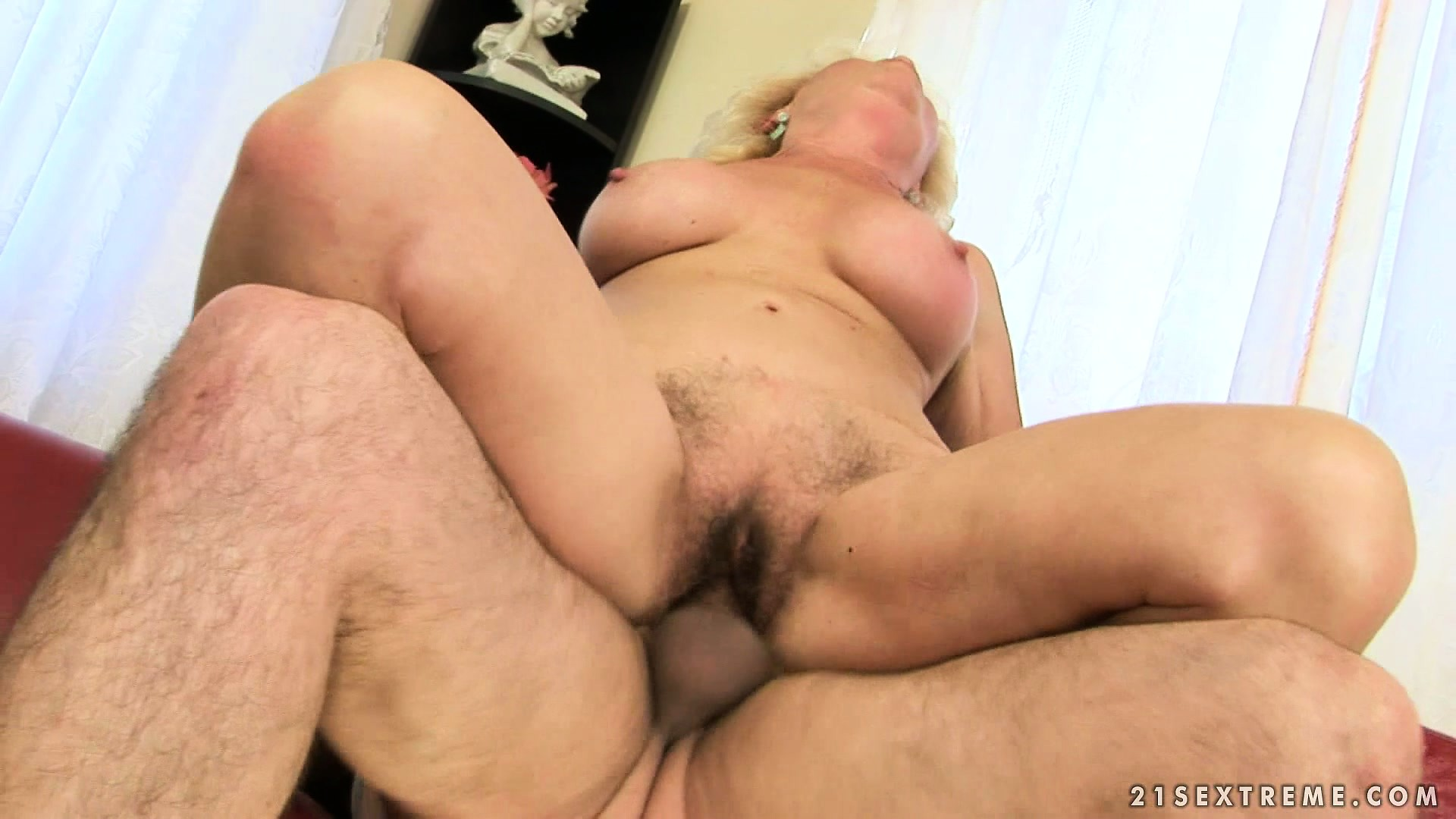 Porn Tube of The Blonde Bounces On That Dick With Excitement Driving Her Hairy Cunt To Climax