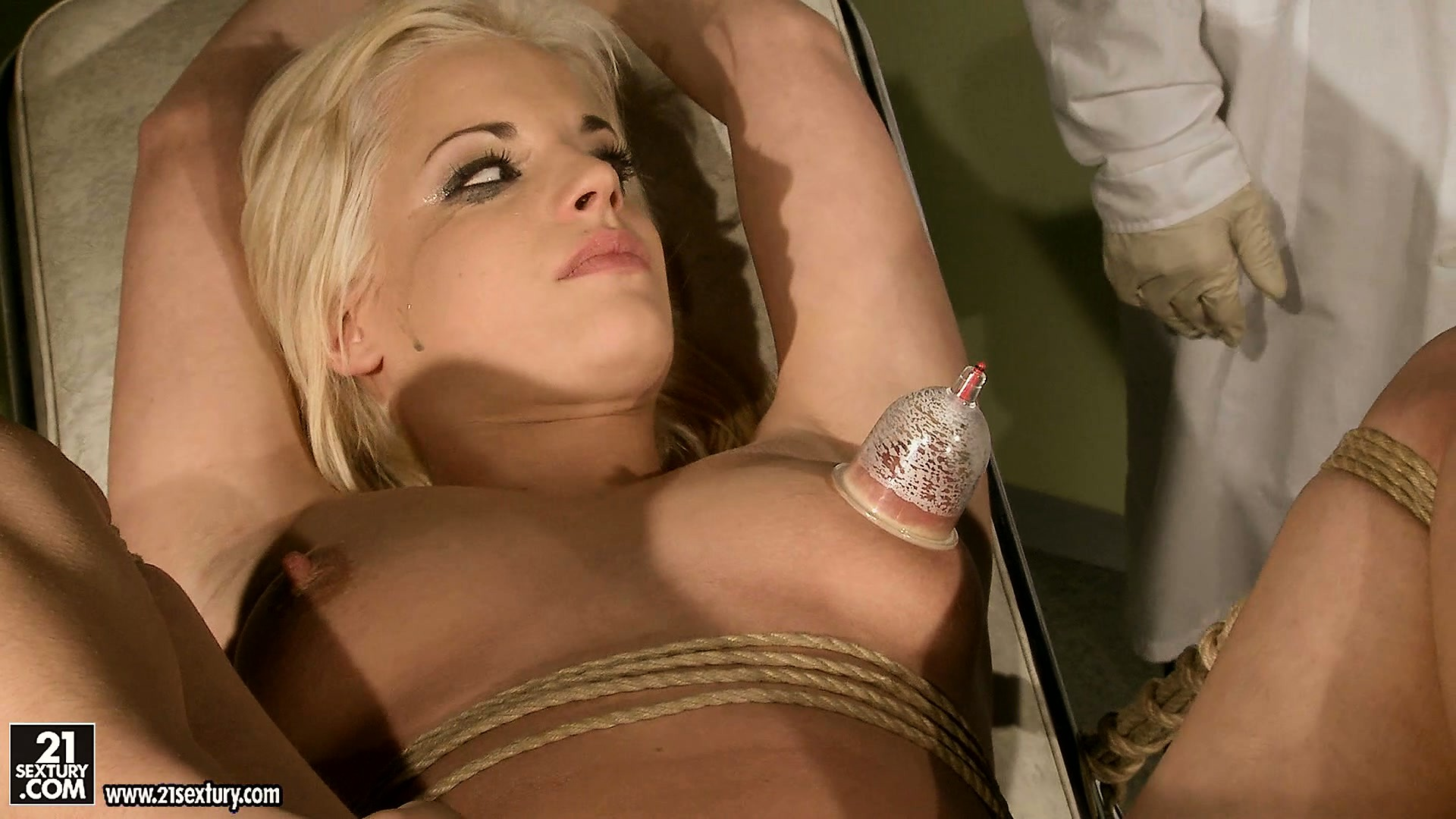 Porn Tube of On The Operating Table, This Evil Doctor Tortures A Blonde Babe With Clamps And Pumps