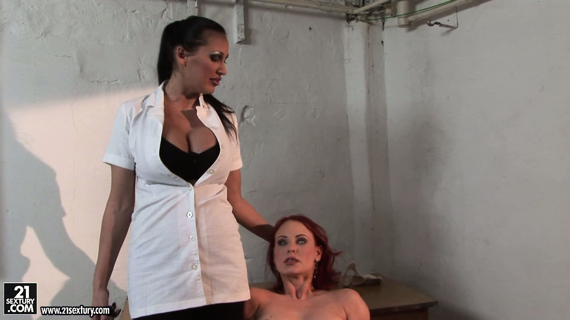 Porno Video of Petite Redheaded Slave In Bondage Gets Teased By A Busty Brunette
