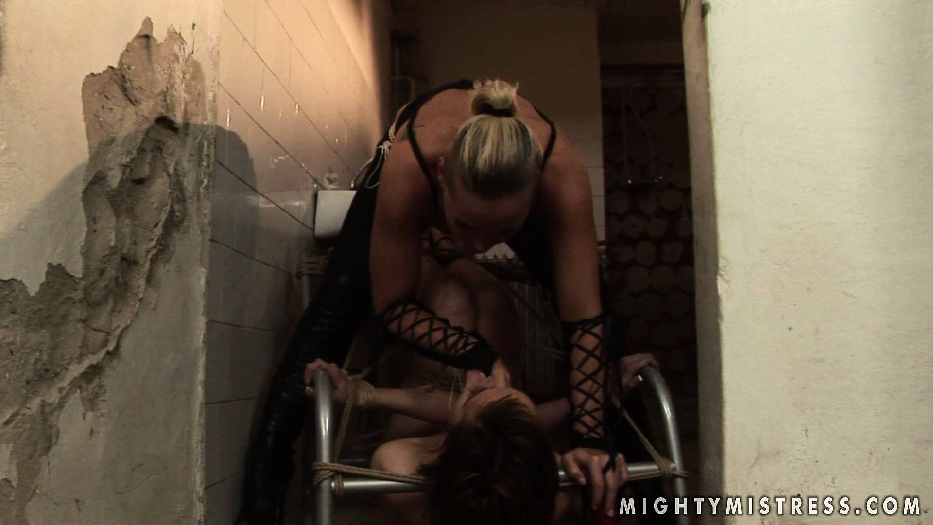 Porno Video of Short-haired Brunette Tramp Gets Punished By Her Hot Mistress