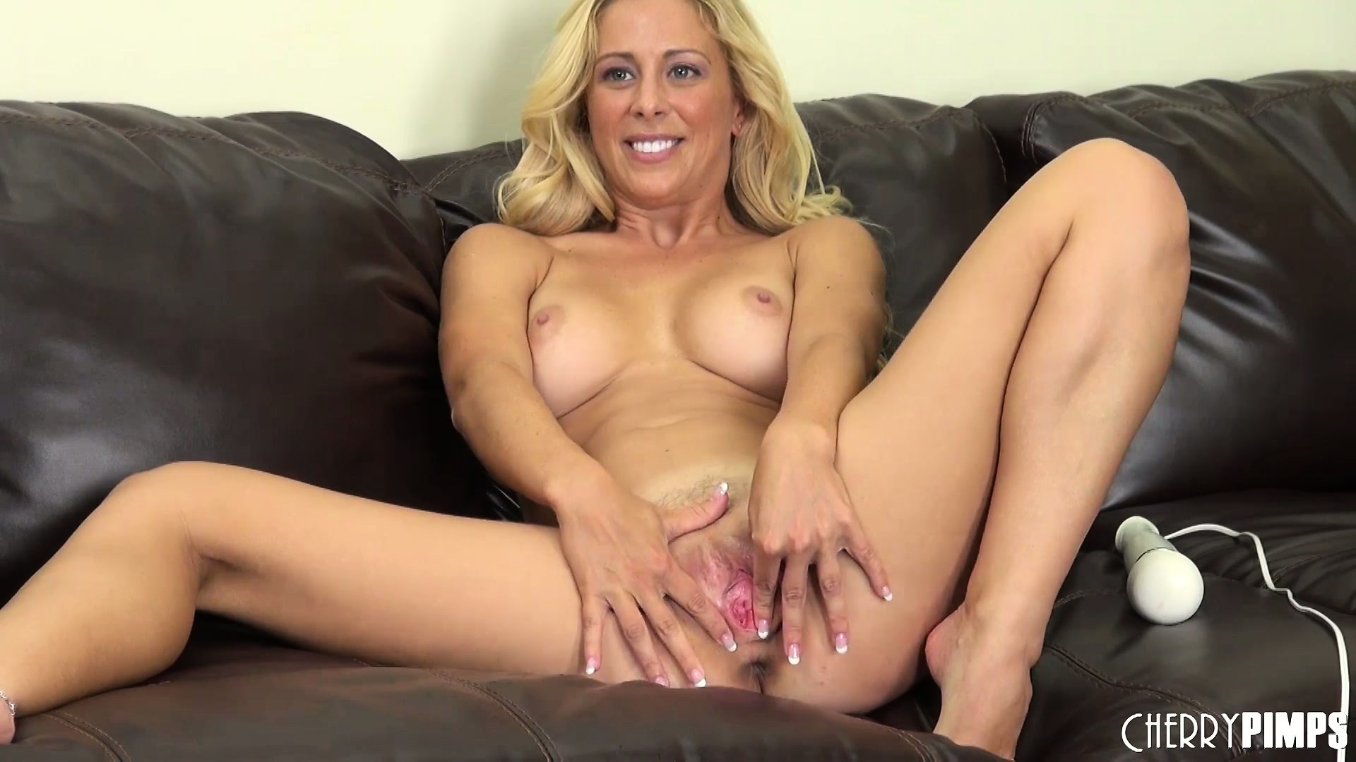 Porno Video of Cherie Deville Enjoys Using Her Vibrator On The Leather Couch