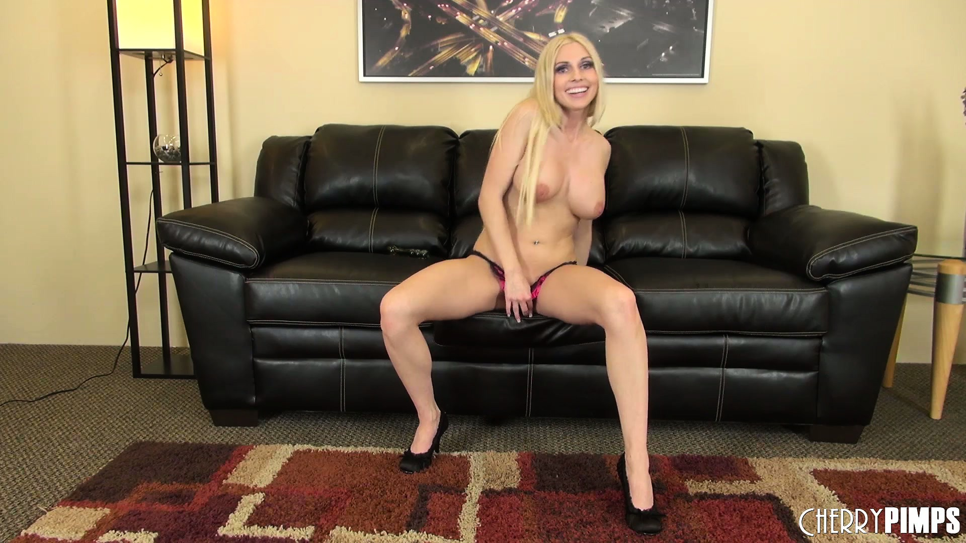 Porno Video of Busty Blonde Hottie Christie Stevens Poses And Does A Striptease
