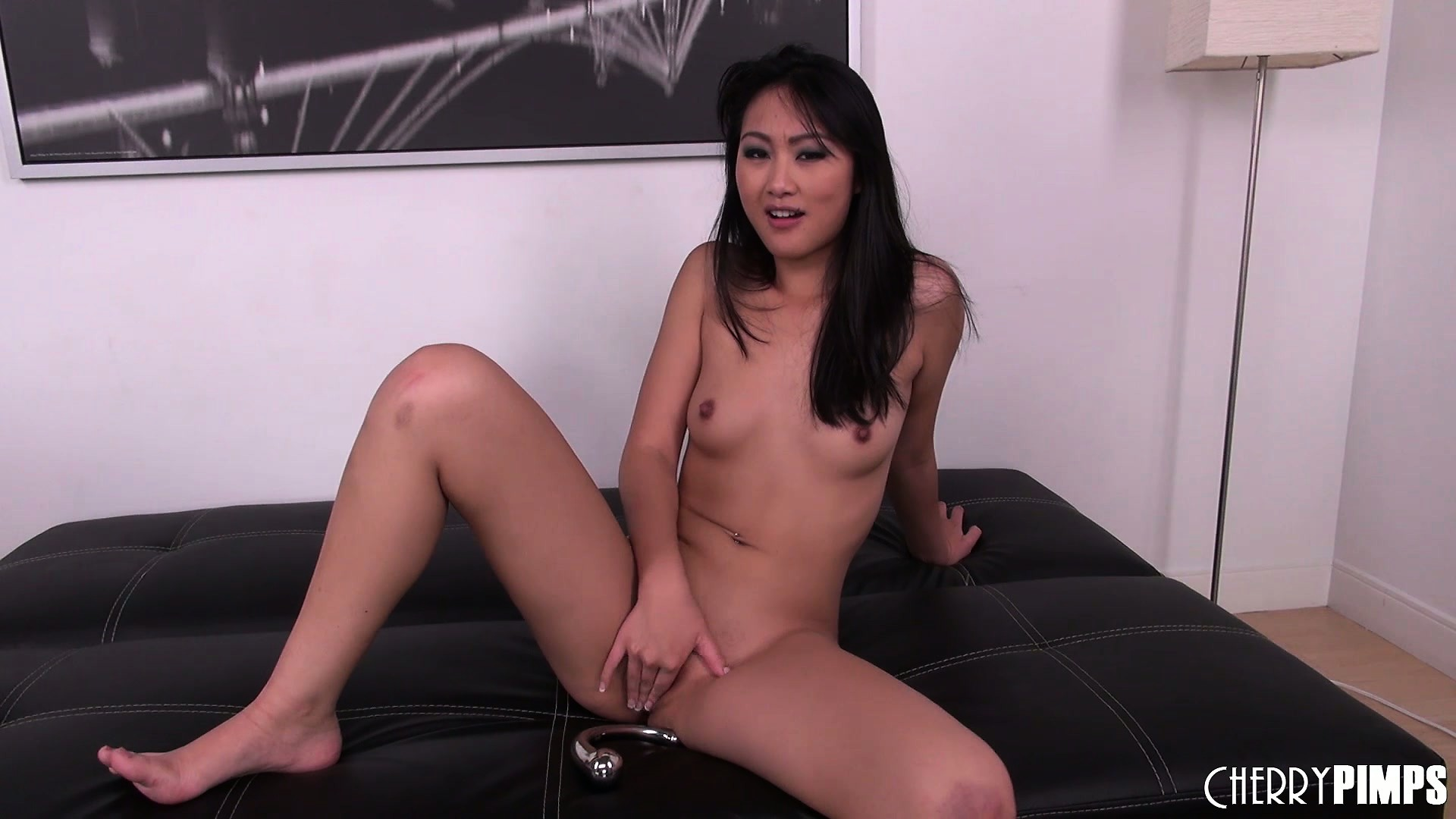 Porno Video of Asian Babe Evelyn Lin Fingers Her Twat From Behind And In Front