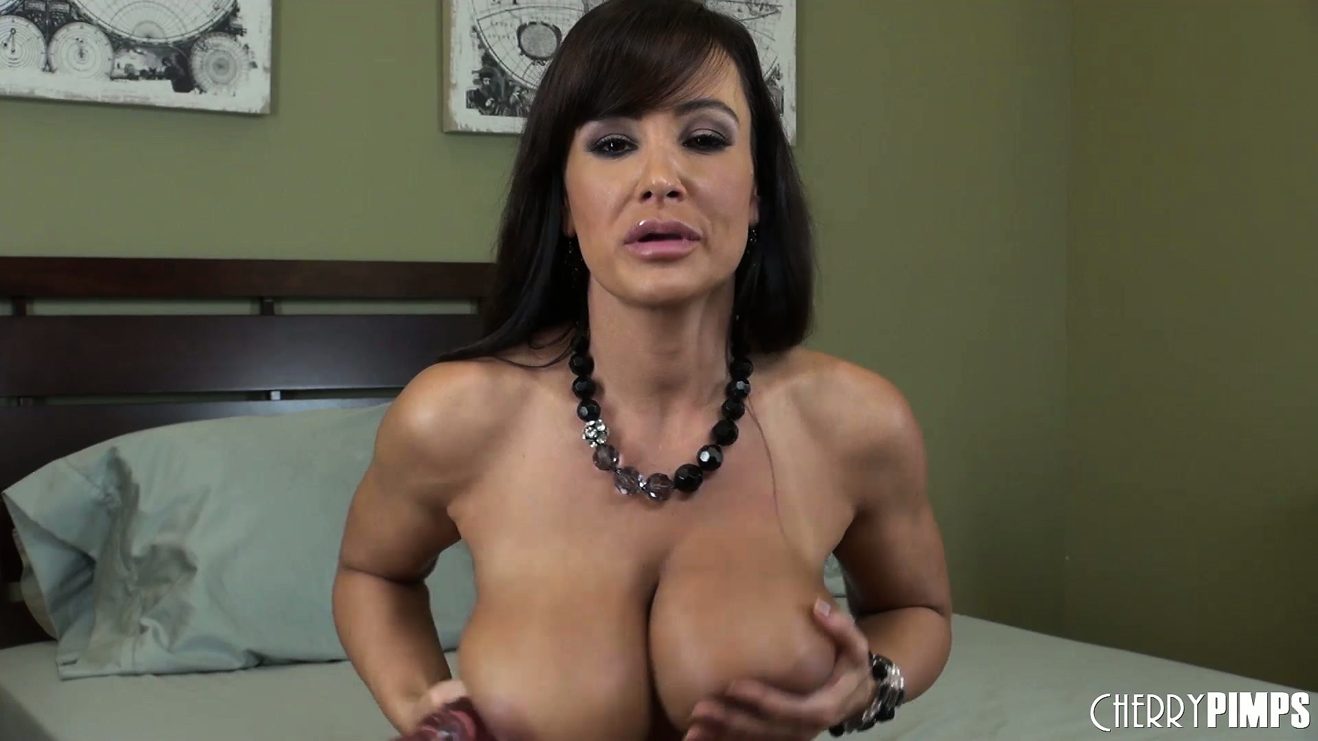 Porno Video of Lisa Ann Gets Down And Dirty As She Bangs Her Trimmed Bush On The Bed