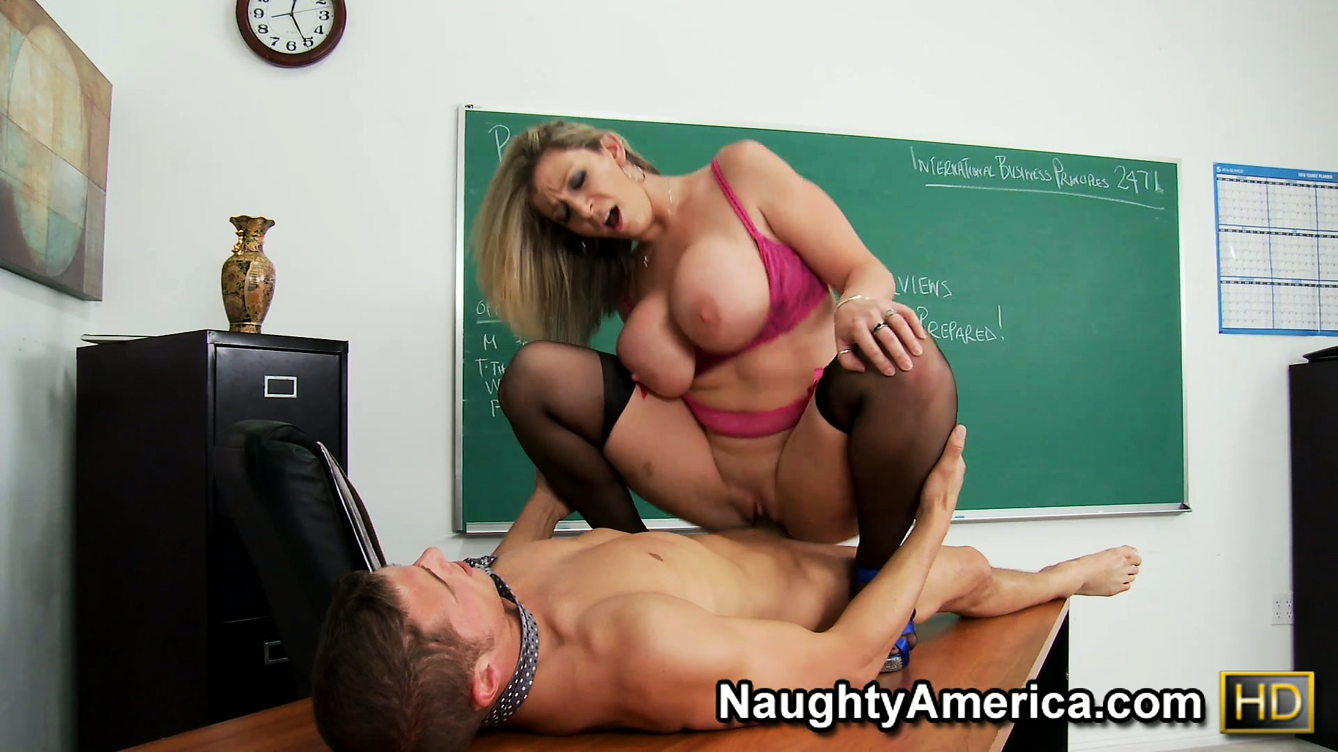 Porno Video of Busty Mature Bitch Sara Jay Drives His Dick Deep On The Classroom Desk