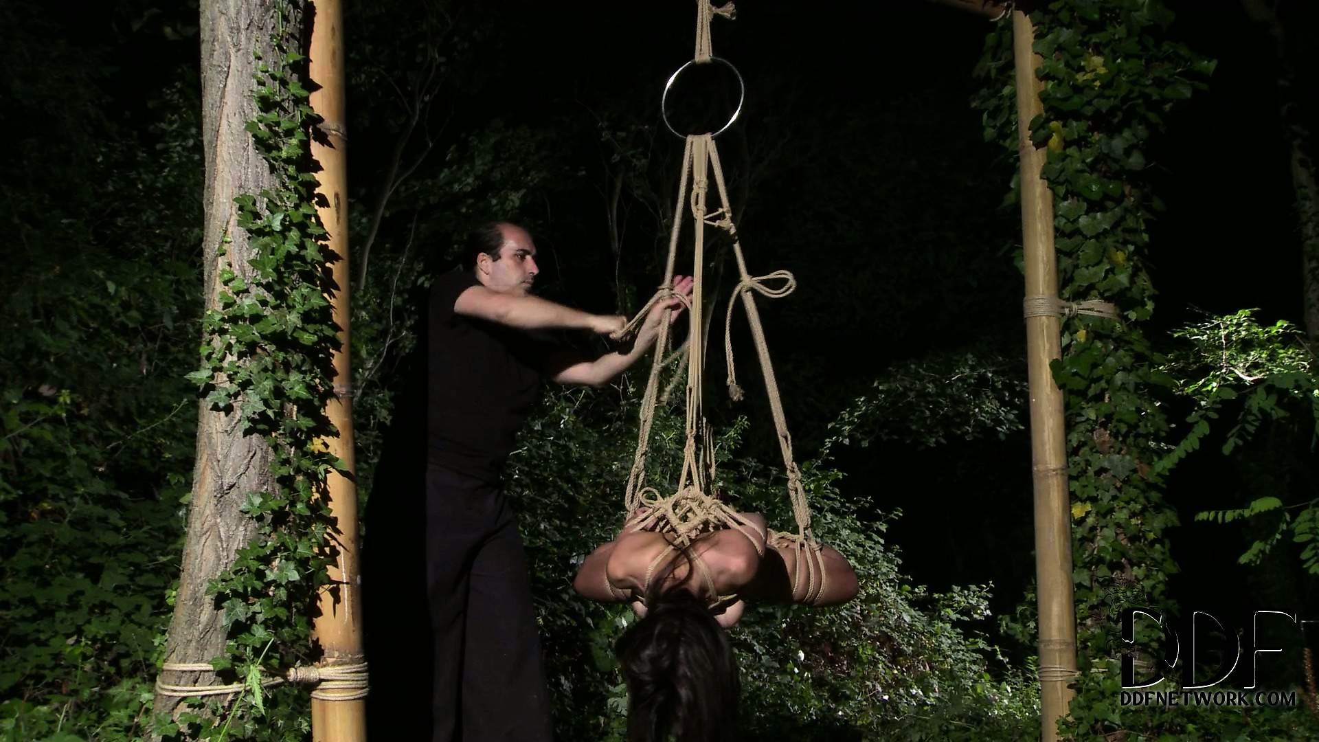 Porno Video of He Hangs His Naked Asian Slave Up In The Tree And Leaves Her There For The Night