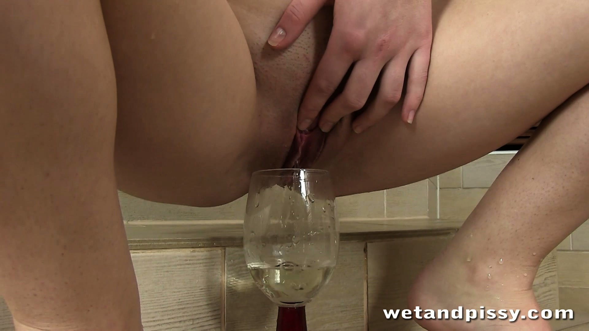 Porn Tube of Buck Naked Teen Beauty Fills Up A Wine Glass By Peeing Into It