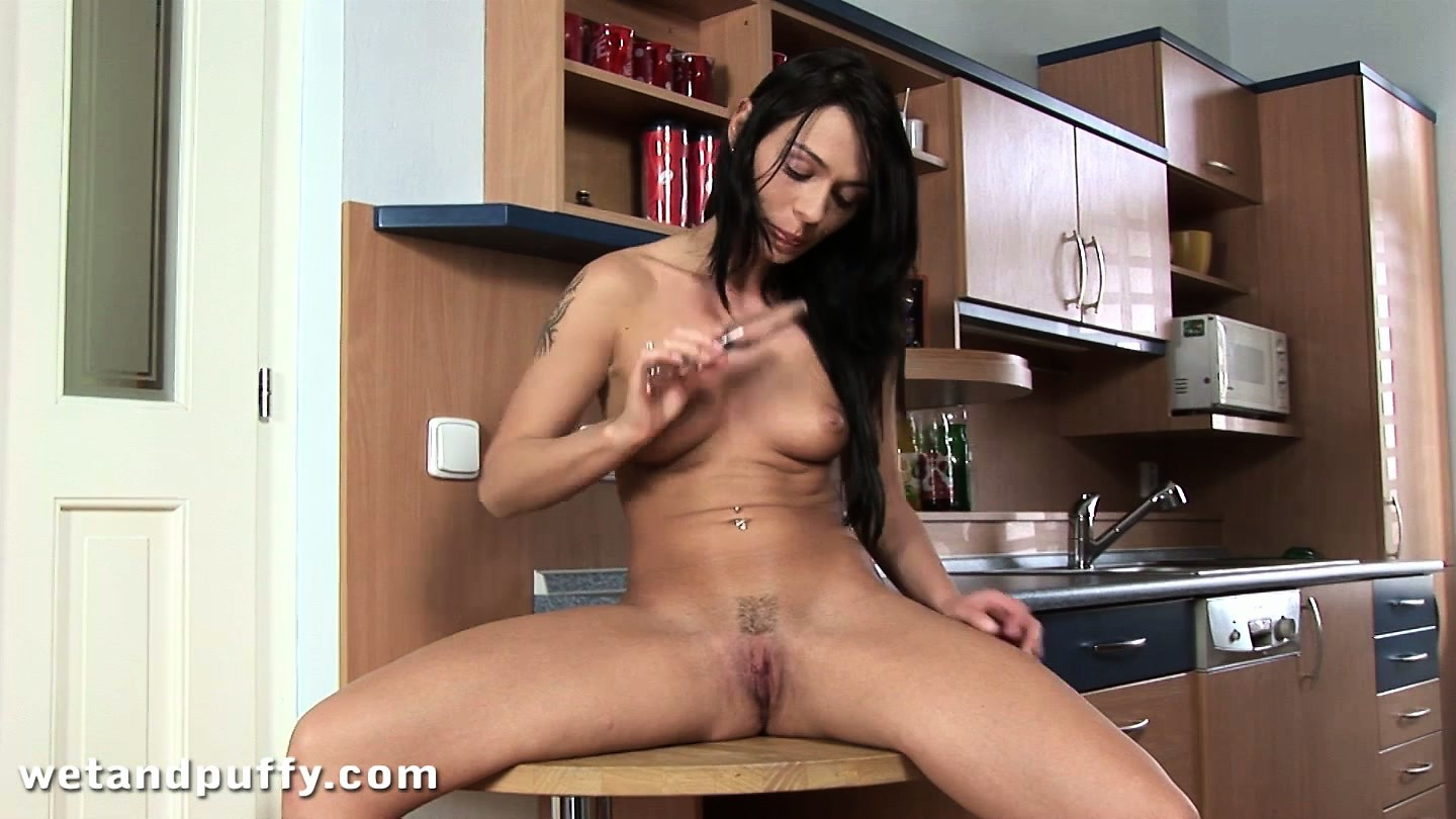 Porno Video of Skinny Brunette Broad Rubs Her Pretty Pussy Lips To Get Moist