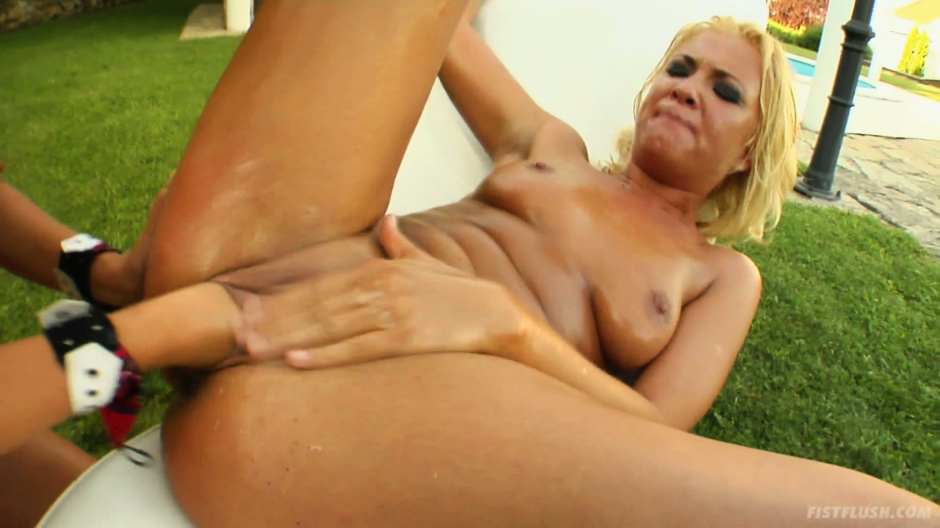 Porno Video of Blondes Mel And Angelic Takes Turns Fisting In The Backyard By The Pool