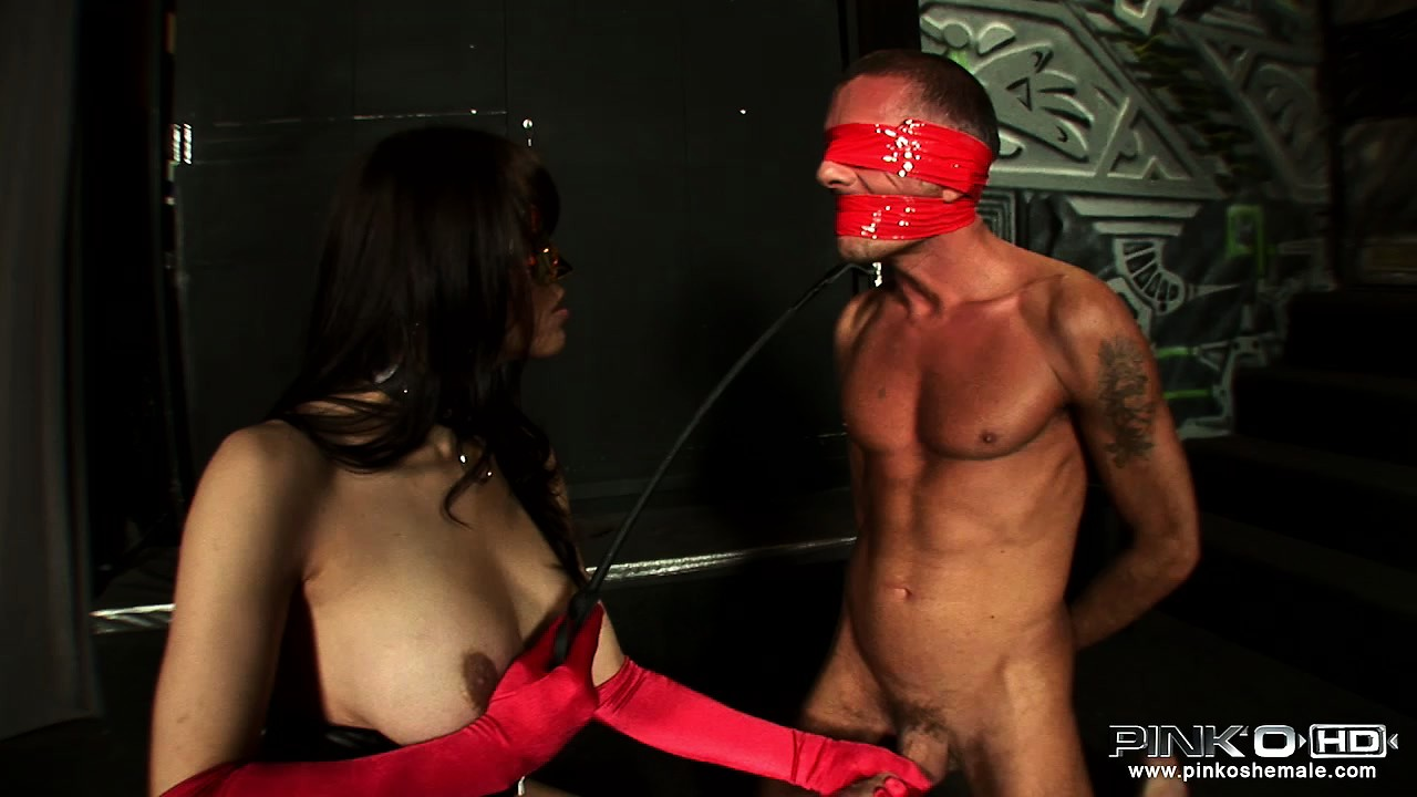 Porno Video of Big Tit Latex Clad Shemale Mistress Blows And Teases Her Masked Slave