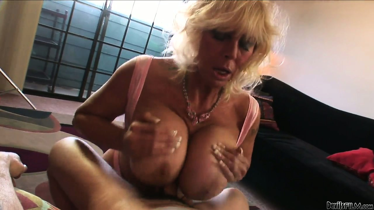 Porn Tube of Grandma Wakes Her Boy Toy Up With A Titty Fuck And Some Head
