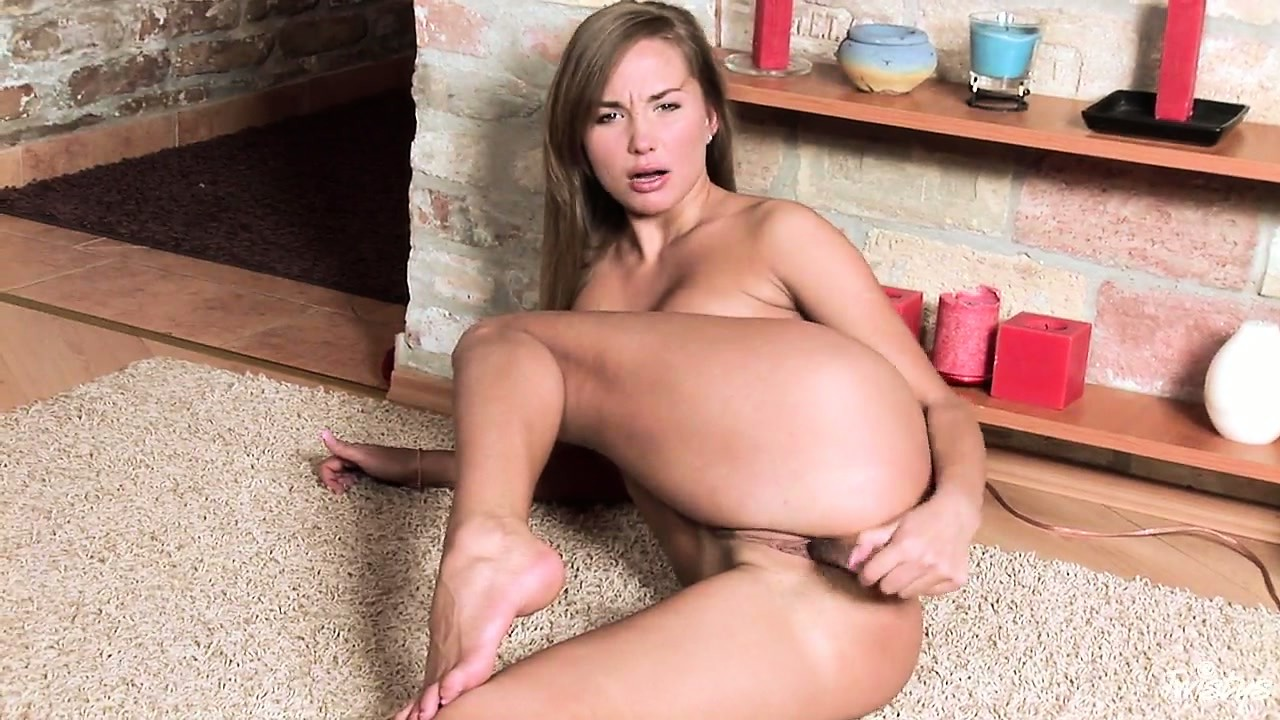 Porno Video of Jessie Spreads Her Long Legs And Stuffs Her Coot With Transparent Dildo