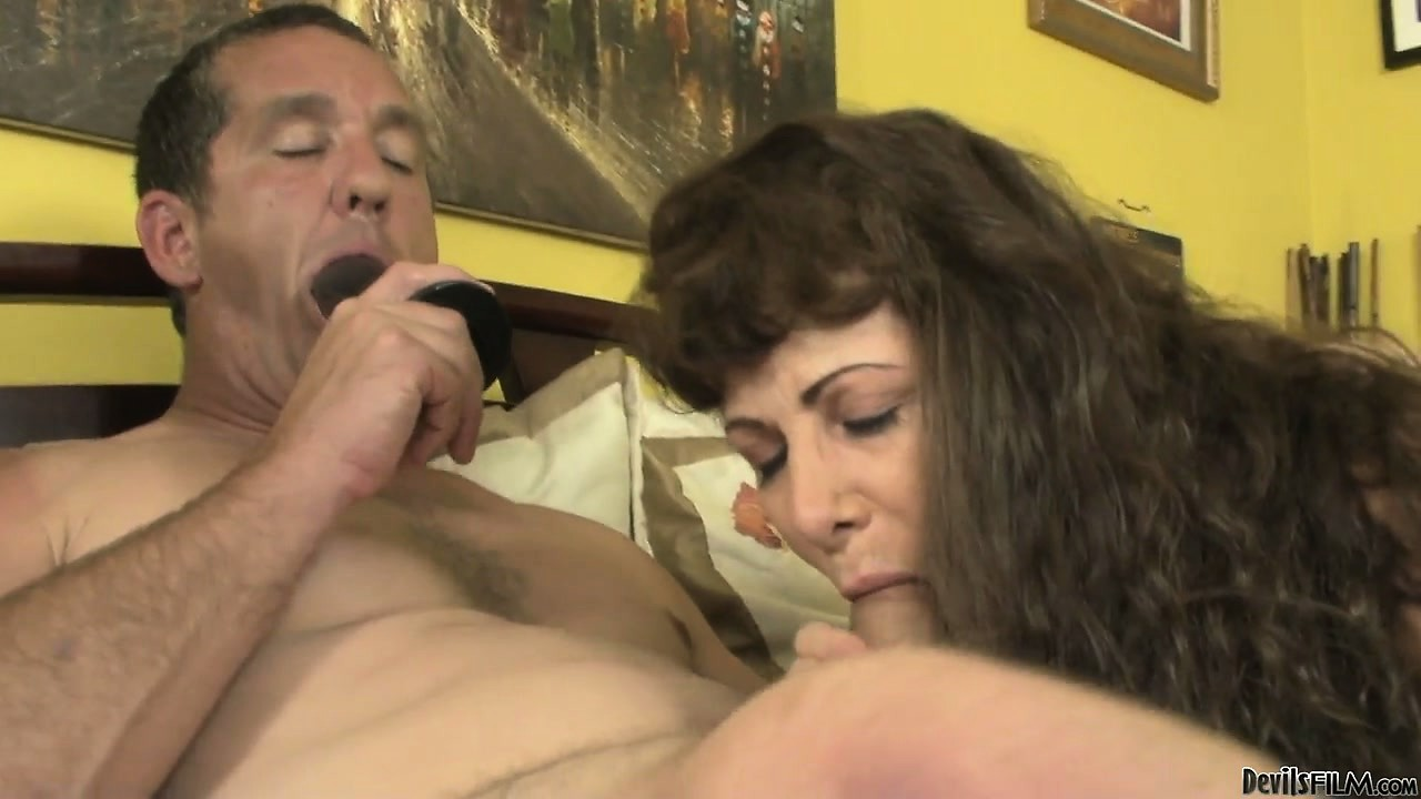 Porno Video of Naughty Daddy Sucking On A Dildo While His Wife Is Blowing His Cock