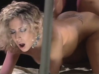 luscious blonde with lovely tits gets her twat fucked hard behind bars